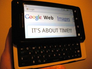 """Jessica's new smart phone with the text """"IT'S ABOUT TIME!!!"""" on the screen."""